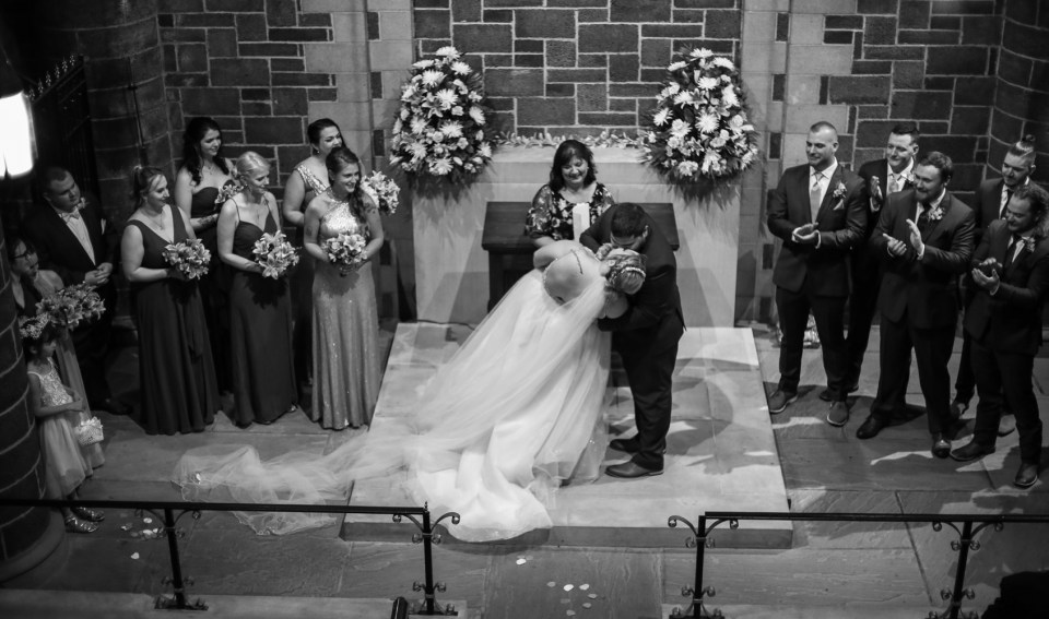 First kiss in the chapel at Beach Glass Estates wedding