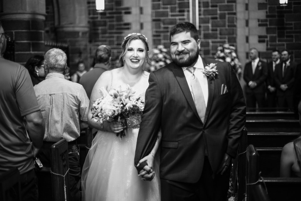 Smiling couple during recessional at Beach Glass Estates wedding