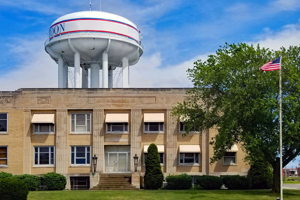 Mattoon City Hall with water town in background.