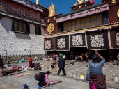 Devoted Buddhists prostrating in front of Jokhang Temple