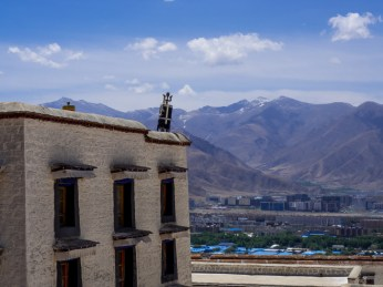 The Drepung Monastery in contrast to Lhasa new town in the background