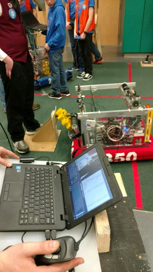 Our new and improved robot putting on a gear (comp 2).