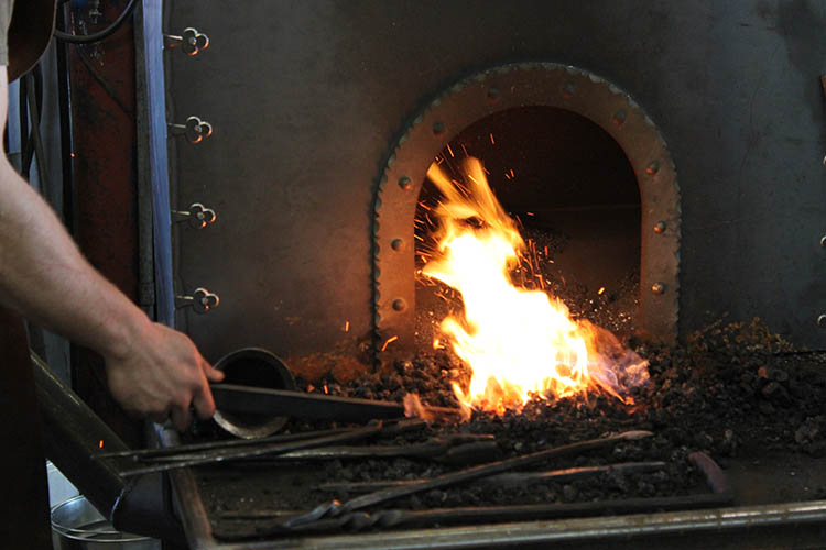 Paul Nyborg heating up the iron in his forge.