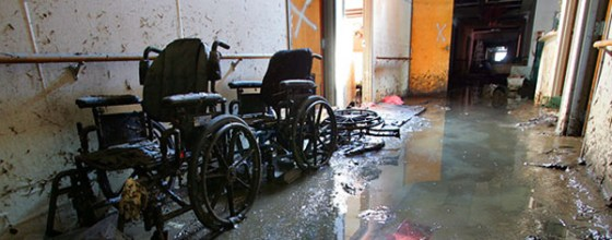 Abandoned wheelchairs and a flooded hallway at St. Rita's Nursing Home