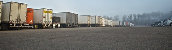 A row of trucks at a truckstop