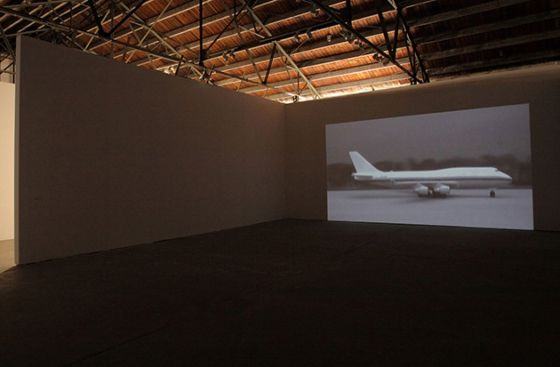 Abstract photo of a plane projected on a blank wall