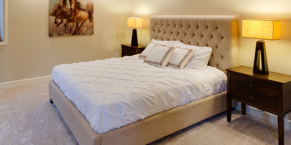 beige bed with white mattress