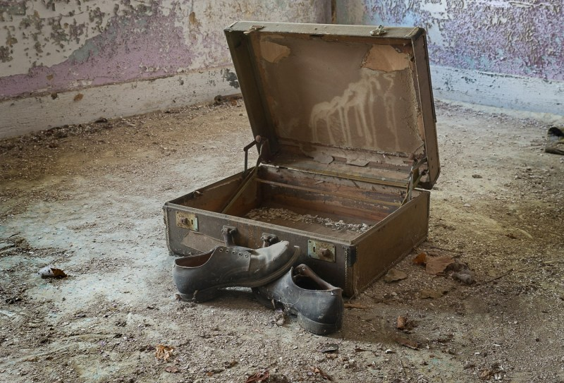 An old briefcase and shoes left behind at an old Ohio poorhouse.