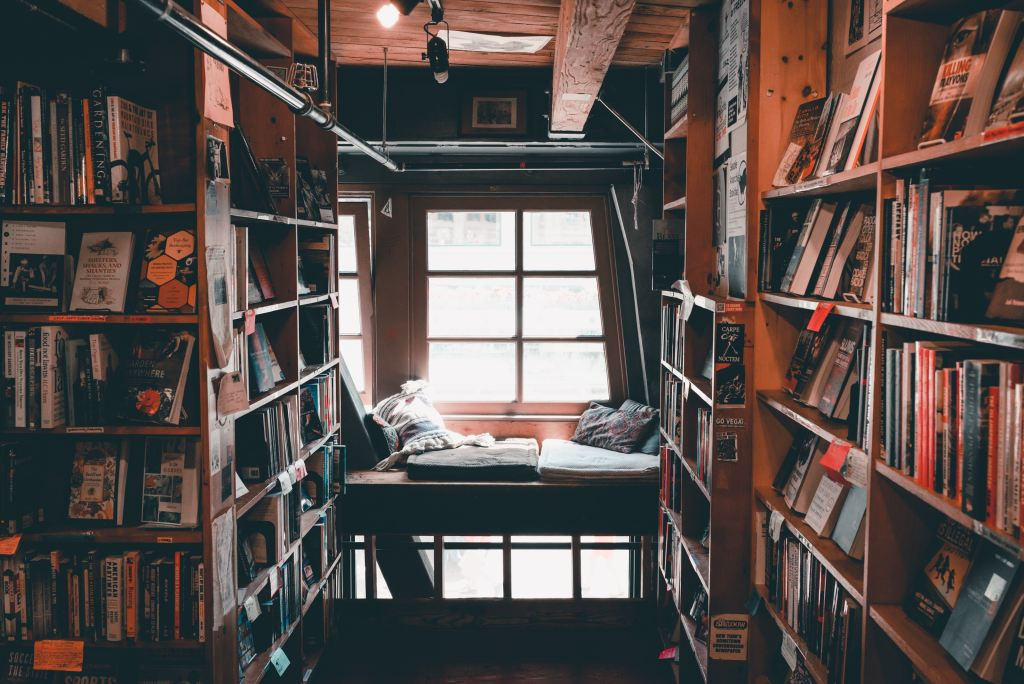 reading or writing nook surrounded by books and shelves