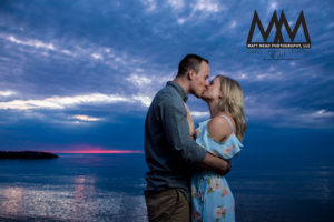 erie pa engagement kissing on beach photo