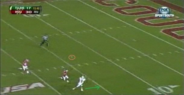 Griffin gets the ball over 50 yards down field from the far hash to the near flat.