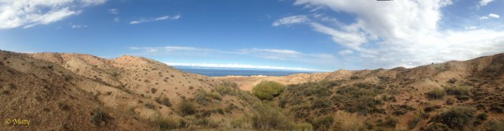 Panorama taken from Skazka with Lake Issyk Kul in the background