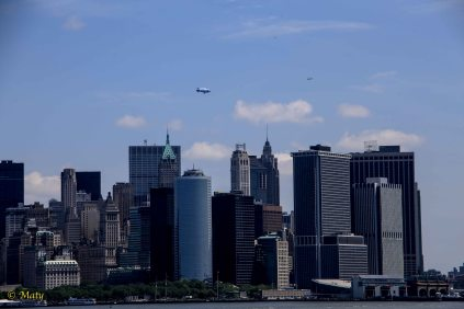 Airship flying above NYC with airliner cruising in the distance. It is very busy airspace!