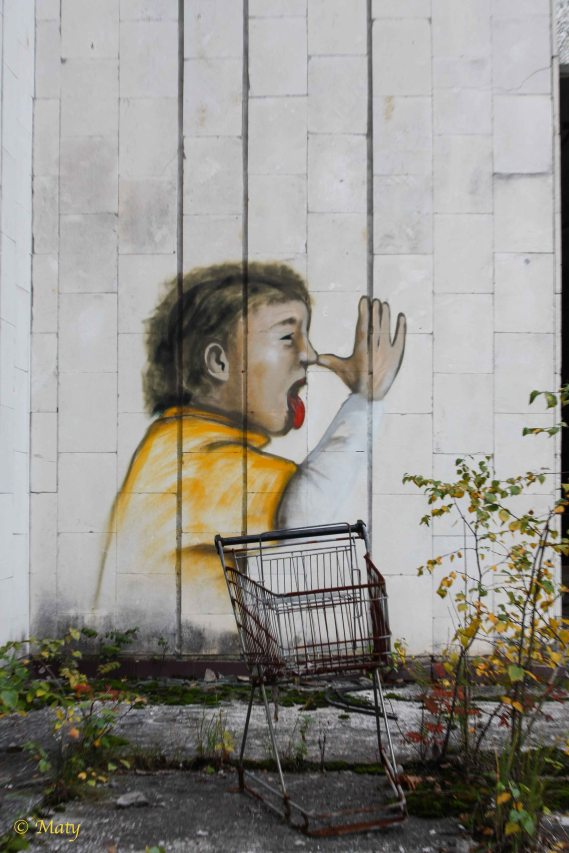 "shopping cart and some ""out of this world"" graffiti - city of Pripyat"