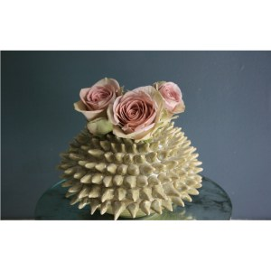 Spiky-green-sea-urchin-vase-with-roses