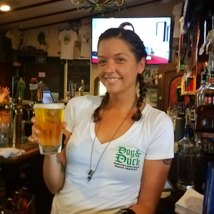 dog and duck irish pub - bartender kellie irwin with pigtails and beer