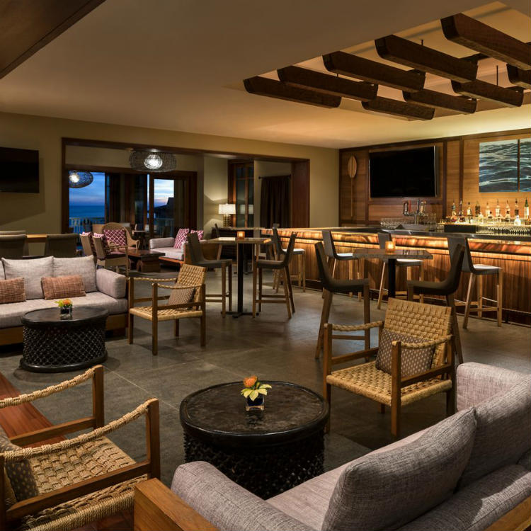 interior of alaloa lounge at ritz carlton kapalua maui - happy hour