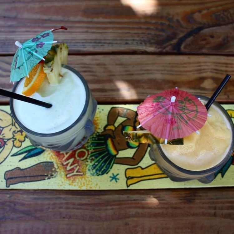 happy hour tropical drinks with umbrellas in maui hawaii