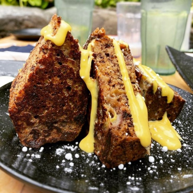 Down the Hatch Breakfast - Banana Bread French Toast drizzled with Lilikoi Cream Cheese