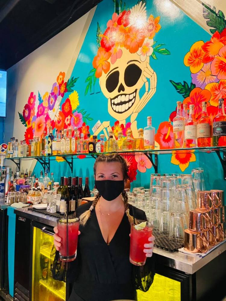 Meg Heath, Maui bartender, with mask and cocktails at La Catrina Cantina, new restaurant in Wailea, Hawaii
