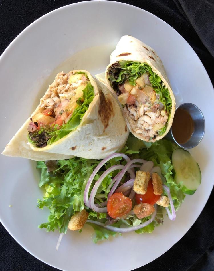 Jerk Chicken Wrap with Side Salad at Captain Jacks Maui Restaurant