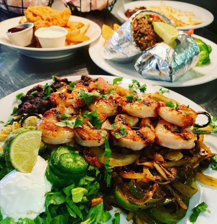 Happy hour grilled shrimp skewers at Milagros Food Co Paia HI