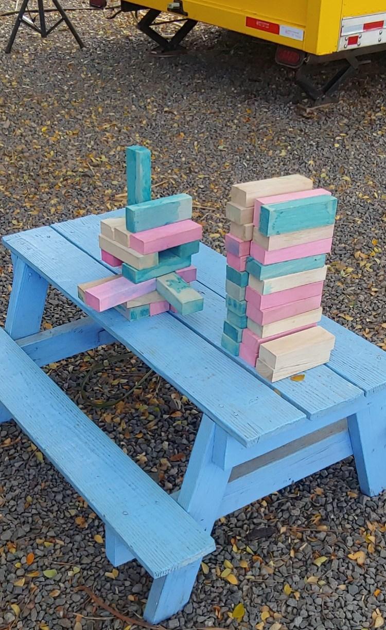 kids picnic table with Jenga game at Maui Taco Loco