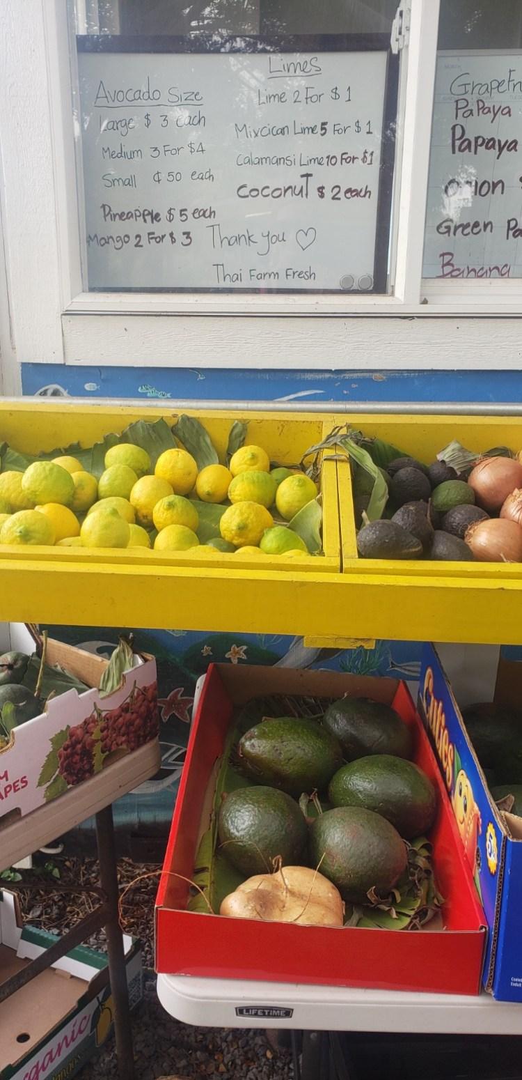 big avocados and lemons at maui hawaii fruit stand