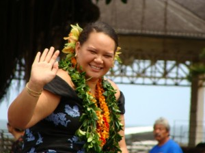 Cherissa Henoheanapuaikawaokele Kane of Halau Kealaokamaile waves spectators along the Merrie Monarch parade route after winning the title of 2009 Miss Aloha Hula in the 46th Annual event.