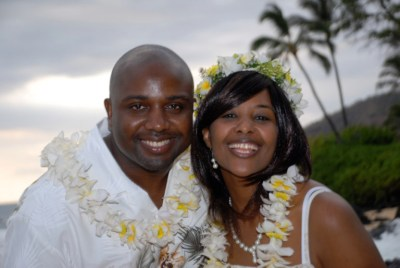 Maui beach wedding with head lei
