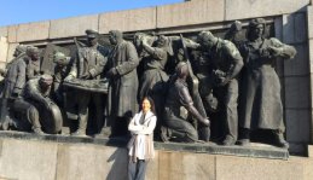 Posing in front of public art in Sofia, Bulgaria, former bastion of Soviet era communism.