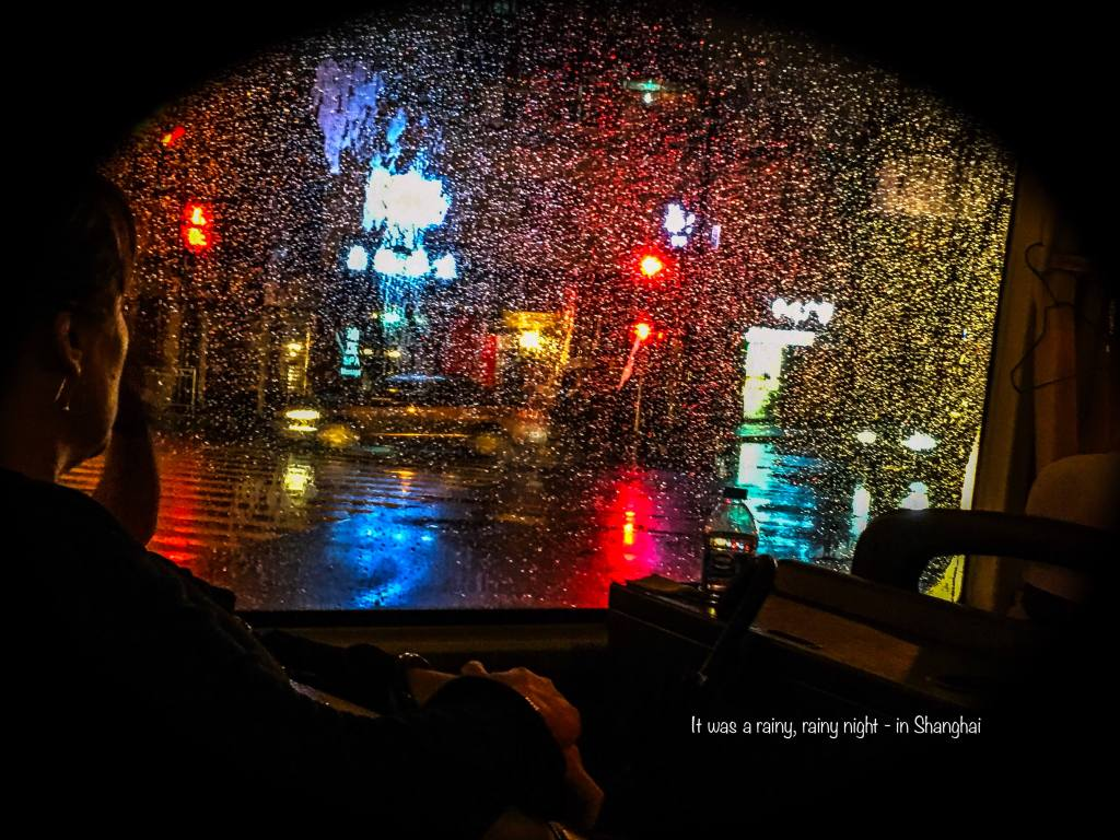 The colours of Shanghai shone through the rainy night