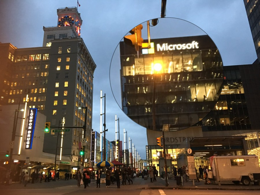 Buildings on Granville Street Vancouver at dusk with the Microsoft building highlighted in a bubble