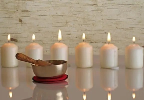 Golden Singing Bowl with candles
