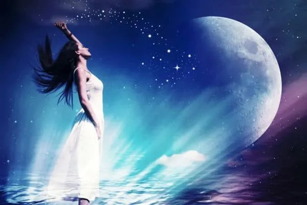 Woman in white dress casting stardust blue and purple cosmic background
