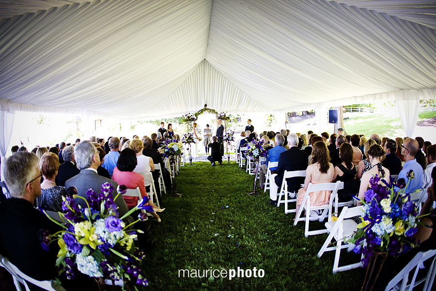 A wedding ceremony under a tent