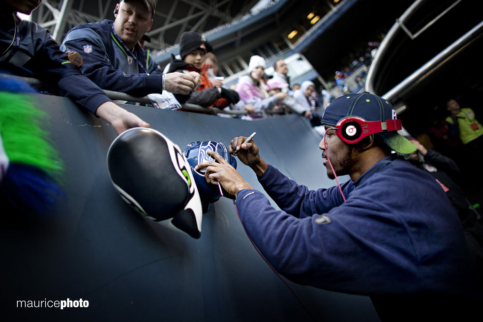 Seattle Seahawk receiver Nate Burleson signs autographs at Qwest Field.