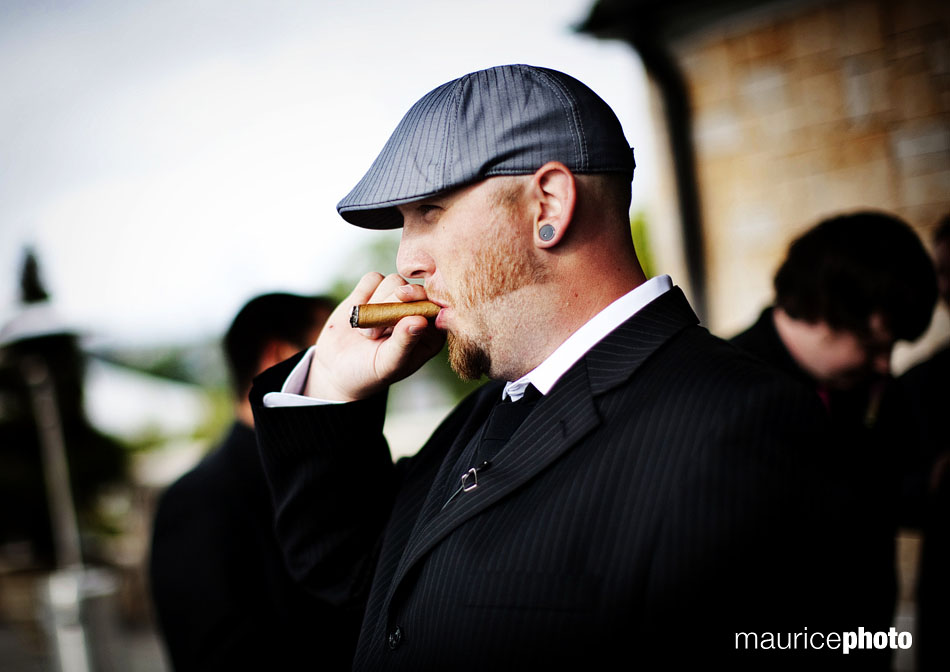 Wedding officiant smoking a cigar
