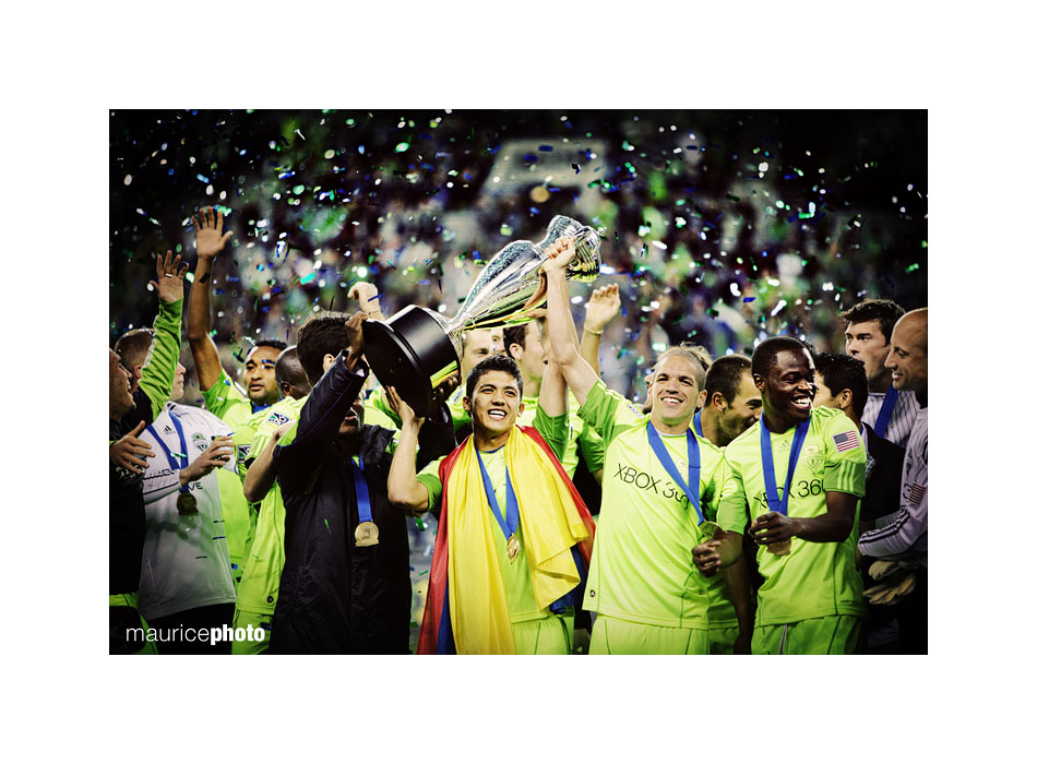 Members of the Seattle Sounders lift the US Open Cup.