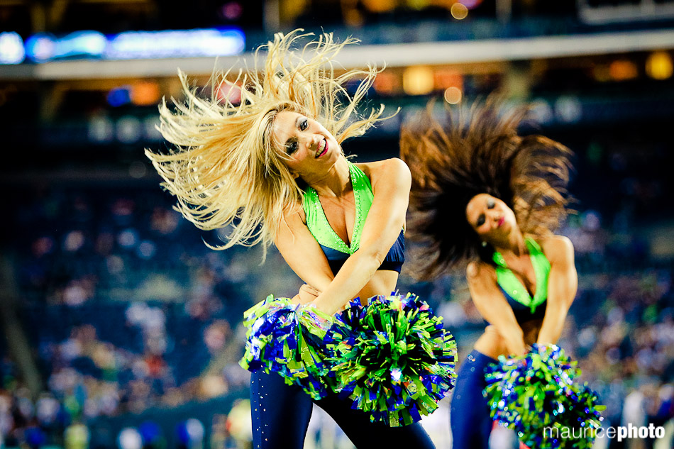 pictures of the Seahawks cheerleaders at an nfl football game.