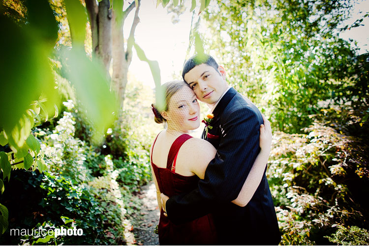 A wedding couple pose for artistic wedding portraits in Seattles Capitol Hill neighborhood.