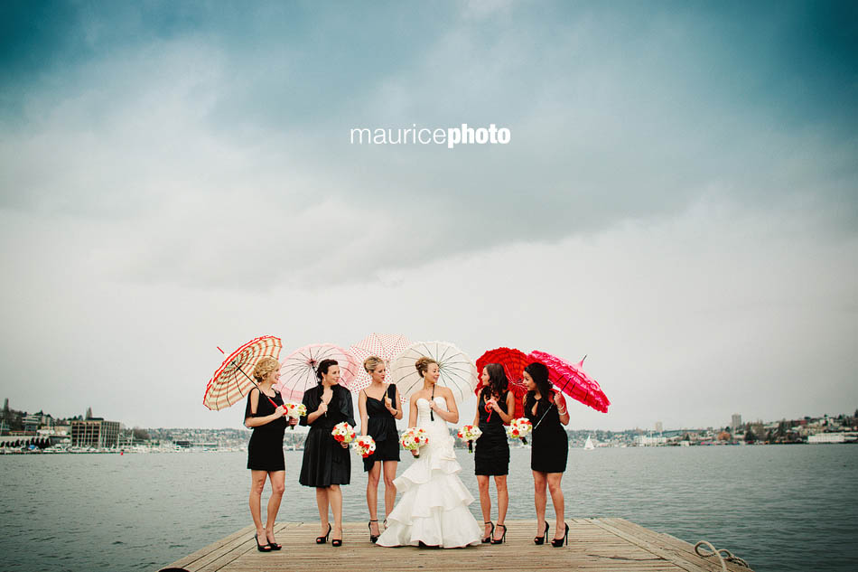Bride and bridesmaids pose for wedding pictures on Lake Union in Seattle.