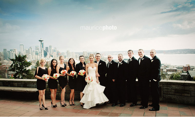 wedding party pictures in front of the Seattle Skyline
