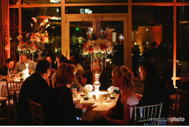 Centerpieces and candles decorate the tables at a Pan Pacific Wedding reception