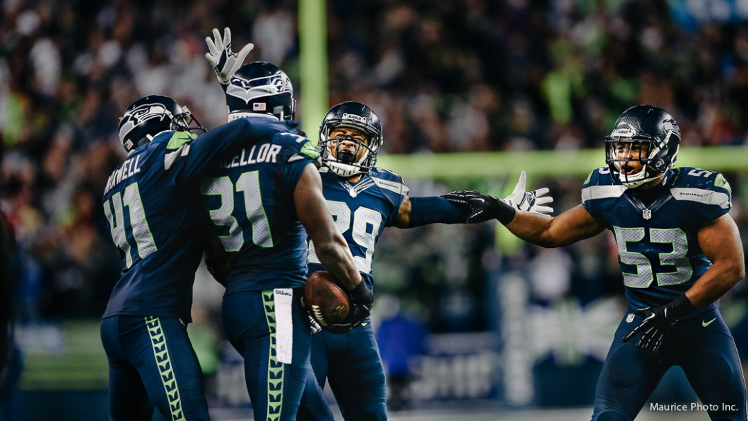 Kam Chancellor and Legion of Boom celebrate an interception