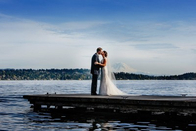 Bride and groom pose for pictures with a Mt. Rainier view.