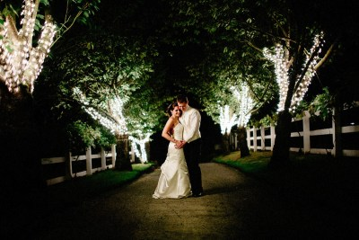 Bride and groom at night at Delille Cellars