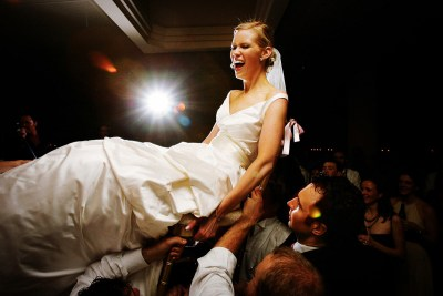 Bride lifted up during horah dance.