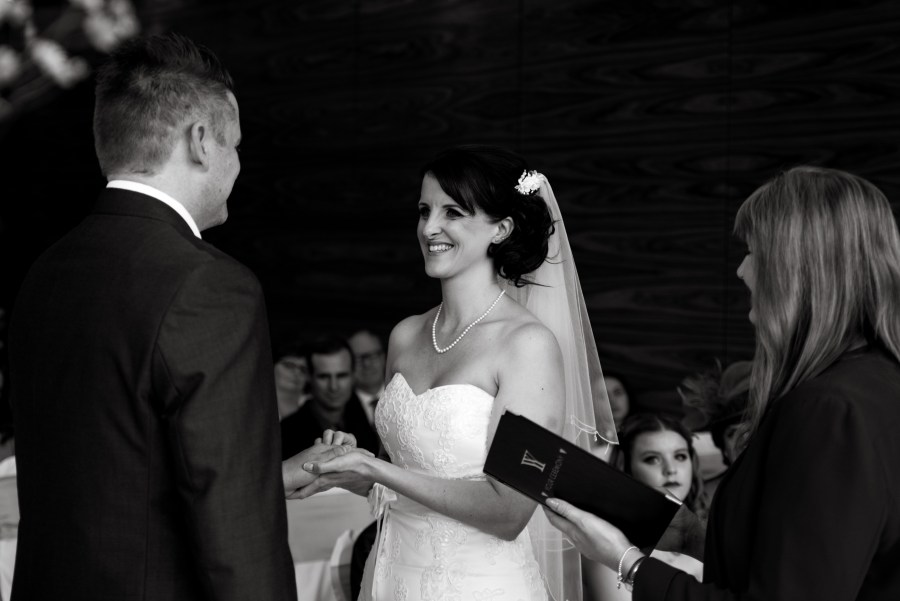 Happy bride and groom during wedding ceremony in North Wales