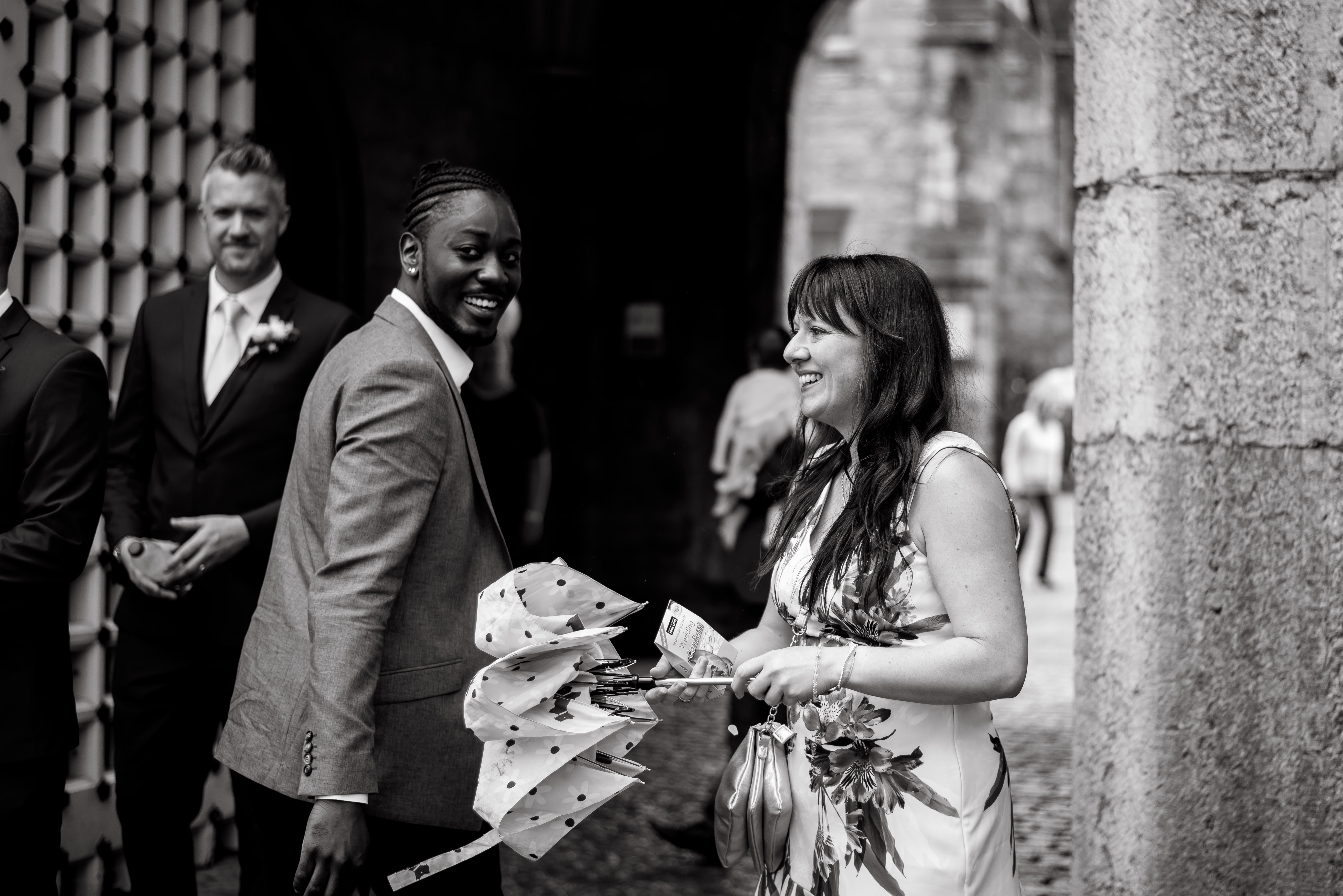 Wedding Photographer from Denbighshire at Bodelwyddan castle. With the guests laughing and joking.